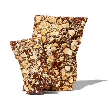 l Migliore Che Buono. Crisp Caramel Toffee, sandwiched between Toasted Flaked Almonds and Dark Chocolate 140g